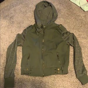Hunter green jacket with grey sleeves and hood